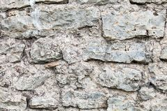 Wall of big stones and broken bricks stock photos