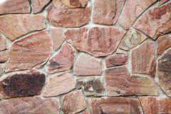 Wall of big stones and broken bricks royalty free stock photography