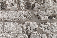 Old wall made of coquina stone Stock Image