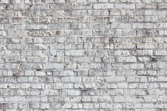 Old wall made of red brick, painted white in loft style for modern designer interior of room. Bar or restaurant royalty free stock photography