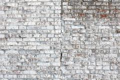 Old wall made of red brick, painted white in loft style for modern designer interior of room. Bar or restaurant royalty free stock photo