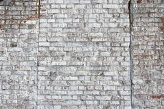 Old wall made of red brick, painted white in loft style for modern designer interior of room. Bar or restaurant stock photography