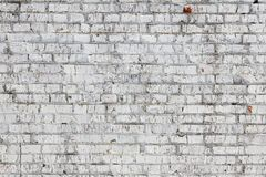 Old wall made of red brick, painted white in loft style for modern designer interior of room. Bar or restaurant stock photo
