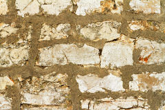 Old wall made of stone and concrete, background. Arcitectural backdrop, stone bricks and concrete Royalty Free Stock Photography