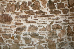 Old wall with many small and big stones Stock Photo