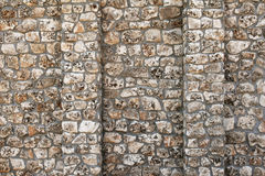 Old wall with many small and big stones Royalty Free Stock Image