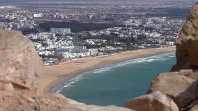 Old wall and Moroccan city beach stock footage