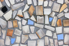 Old wall with a mosaic. Of colored tiles Stock Photos