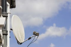 Satellite dish. Old wall mounted satellite dish stock photography