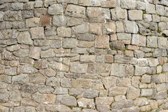 Old wall with natural stones. Old house wall with natural stones. in the mountains Stock Image