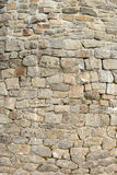 Old wall with natural stones. Old house wall with natural stones. in the mountains Stock Photos