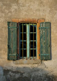Old wall with old volets, Badens, Minervois, France Stock Image