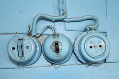 Old wall outlet and switch. In a village house, Russia Royalty Free Stock Photography