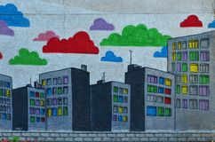 Fragment of an old wall with colorful graffiti paintings royalty free illustration