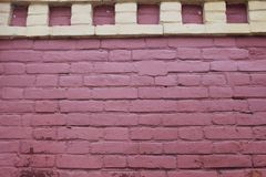 Old wall with pink brick with yellow squares closeup. Stock Photography