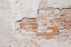 Old wall with plaster and bricks texture Stock Images