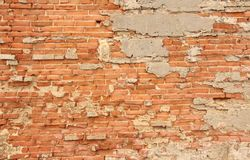 Old Wall of Red Bricks and White Brayed and Cracked Old Paint. Red, Terracotta and White Brick Background. Old Wall for Background royalty free stock photography
