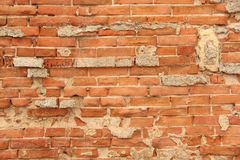 Old Wall of Red Bricks and White Brayed and Cracked Old Paint. Red, Terracotta and White Brick Background. Old Wall for Background stock images