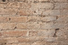 Old Wall of Red Bricks and White Brayed and Cracked Old Paint. Red, Terracotta and White Brick Background. Old Wall for Background. Design, Design and Template stock image