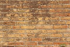 Old Wall of Red Bricks and White Brayed and Cracked Old Paint. Red, Terracotta and White Brick Background. Old Wall for Background. Design, Design and Template royalty free stock images