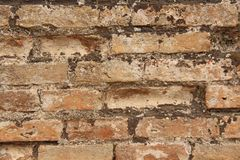Old Wall of Red Bricks and White Brayed and Cracked Old Paint. Red, Terracotta and White Brick Background. Old Wall for Background stock photography