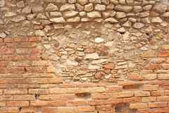 Old Wall of Red Bricks and White Brayed and Cracked Old Paint. Red, Terracotta and White Brick Background. Old Wall for Background. Design, Design and Template stock photography