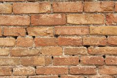 Old Wall of Red Bricks and White Brayed and Cracked Old Paint. Red, Terracotta and White Brick Background. Old Wall for Background. Design, Design and Template stock photo
