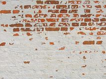 Red, Terracotta and White Brick Background. Old Wall of Red Bricks and White Brayed and Cracked Old Paint. royalty free stock photo