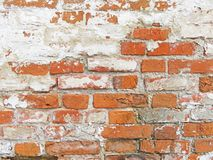 Red, Terracotta and White Brick Background. Old Wall of Red Bricks and White Brayed and Cracked Old Paint. stock photography