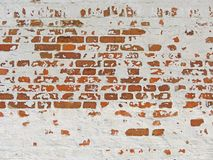 Red, Terracotta and White Brick Background. Old Wall of Red Bricks and White Brayed and Cracked Old Paint. Old Wall of Red Bricks and White Brayed and Cracked stock photo