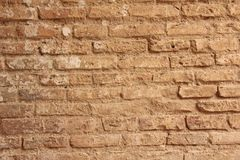 Old Wall of Red Bricks and White Brayed and Cracked Old Paint. Red, Terracotta and White Brick Background. Old Wall for Background stock photo