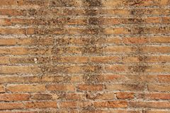 Old Wall of Red Bricks and White Brayed and Cracked Old Paint. Red, Terracotta and White Brick Background. Old Wall for Background. Design, Design and Template royalty free stock image