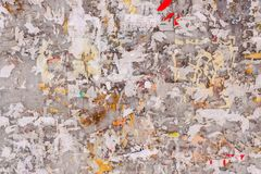 Old wall with remains of paper ads. As background royalty free stock photos