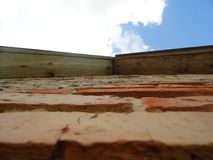 Old wall WITH ROOFS. Part of the old wall with a roof, a beautiful brick Royalty Free Stock Photo