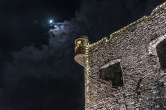 Old wall ruins under the moon in Santa Margherita Ligure town, Italy royalty free stock image