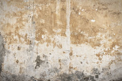 Old wall. Old shabby wall with yellow plaster Stock Photos