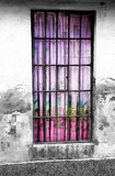 Old wall. With skylight decorated with colorful curtains Stock Image