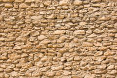 Old wall with small uneven stones Stock Photos