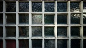 Old wall from square wooden frame and glass. Dirty wall from square wooden frame and glass as background Royalty Free Stock Image