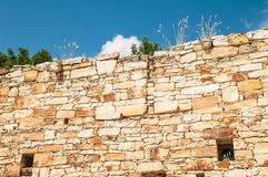 Old wall. Old stone wall with grass Royalty Free Stock Photography