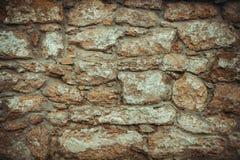 Old wall of stone shell rock of arbitrary shape. toned image. stock image