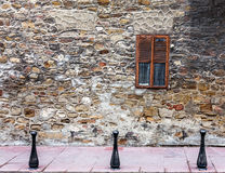 Old wall from stone and window with lattice window Royalty Free Stock Photo