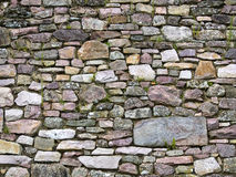 Old wall of stones of a medieval castle Royalty Free Stock Images