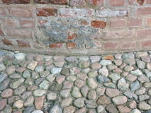 Old wall and stones pavement Stock Images