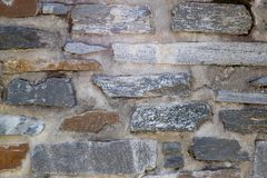 An old wall with stones from rocks royalty free stock images