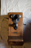 Old wall telephone. Old obsolete retro telephone on wall Royalty Free Stock Photography