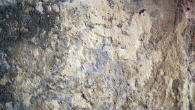 Old wall texture. The old cement walls look like the moon`s surface. Cement wall background. royalty free stock images