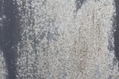 Old wall. texture metal door. it was painted in dark gray. light wear. Royalty Free Stock Image
