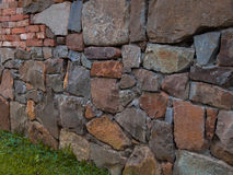 Old wall. Textured old flat brick and stone wall Royalty Free Stock Images