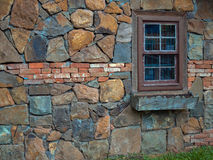 Old wall. Textured old flat brick and stone wall with window Stock Photography